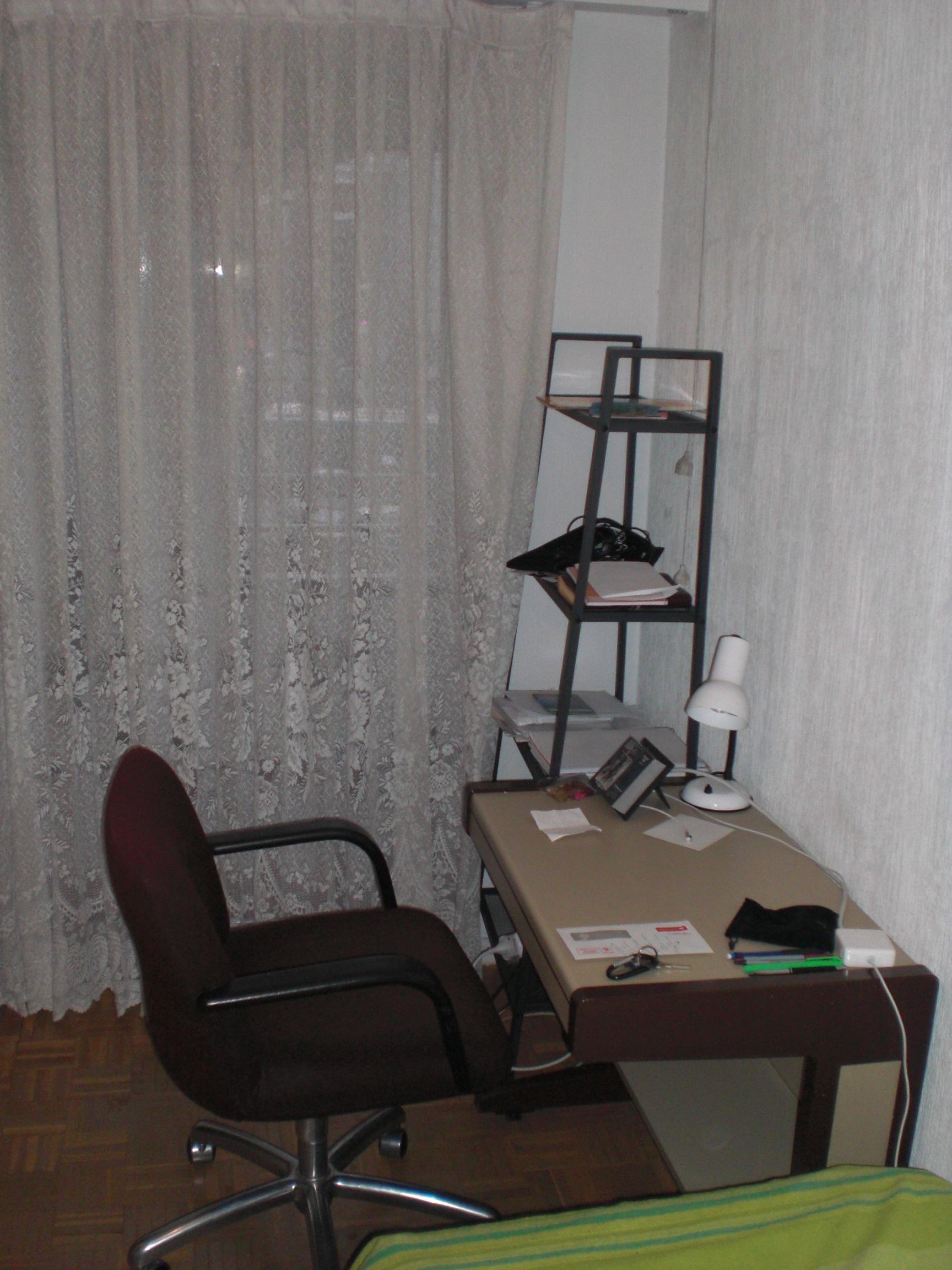 Desk, sliding glass door and shelves