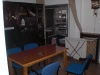 T.V., drying rack and dining table